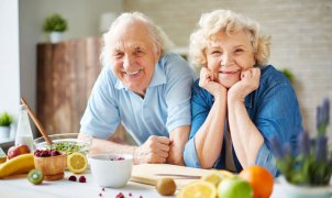 46149837 - happy senior man and woman looking at camera in the kitchen