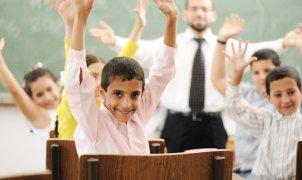 Education activities in classroom at school, children with teacher